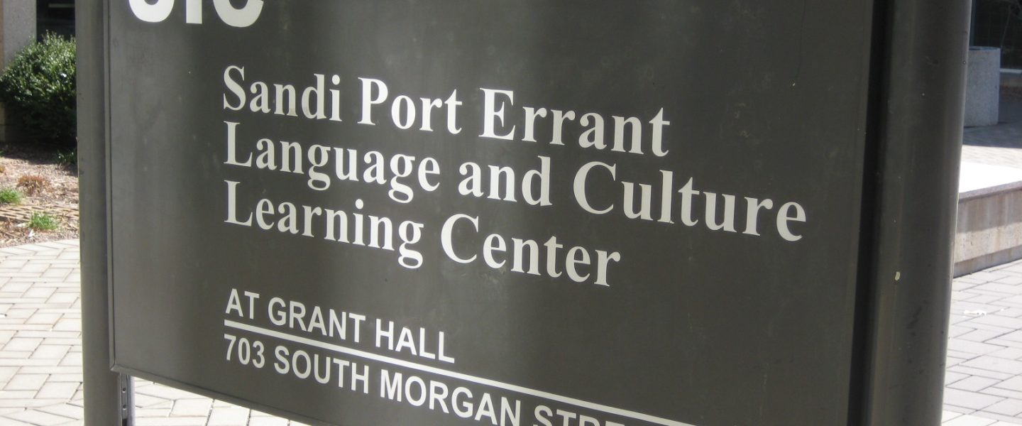 sandi port errant lclc sign in front of the grant hall