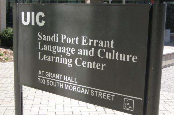 sandi port errant sign in front of GH