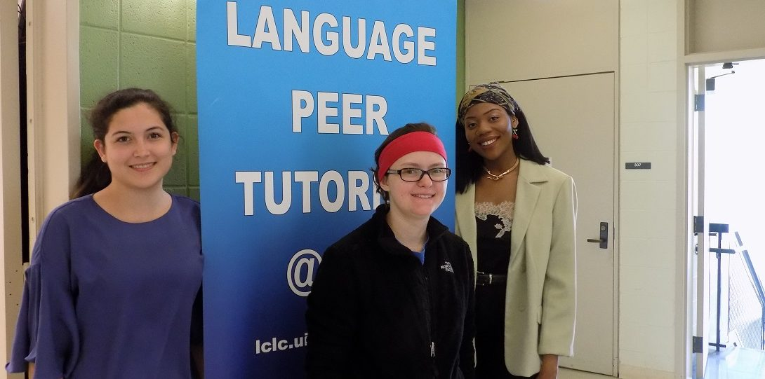 Peer Tutors in front of Language Peer Tutoring Banner