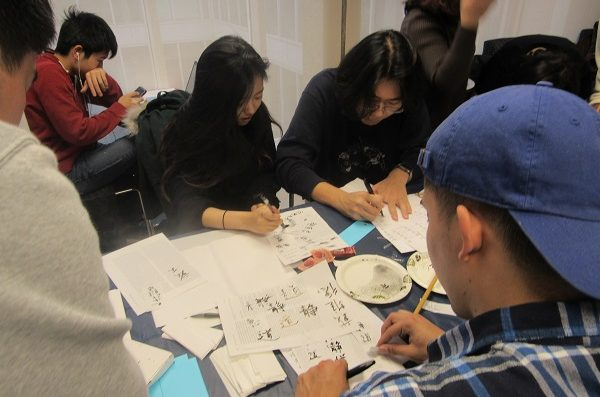 Students writing calligraphy