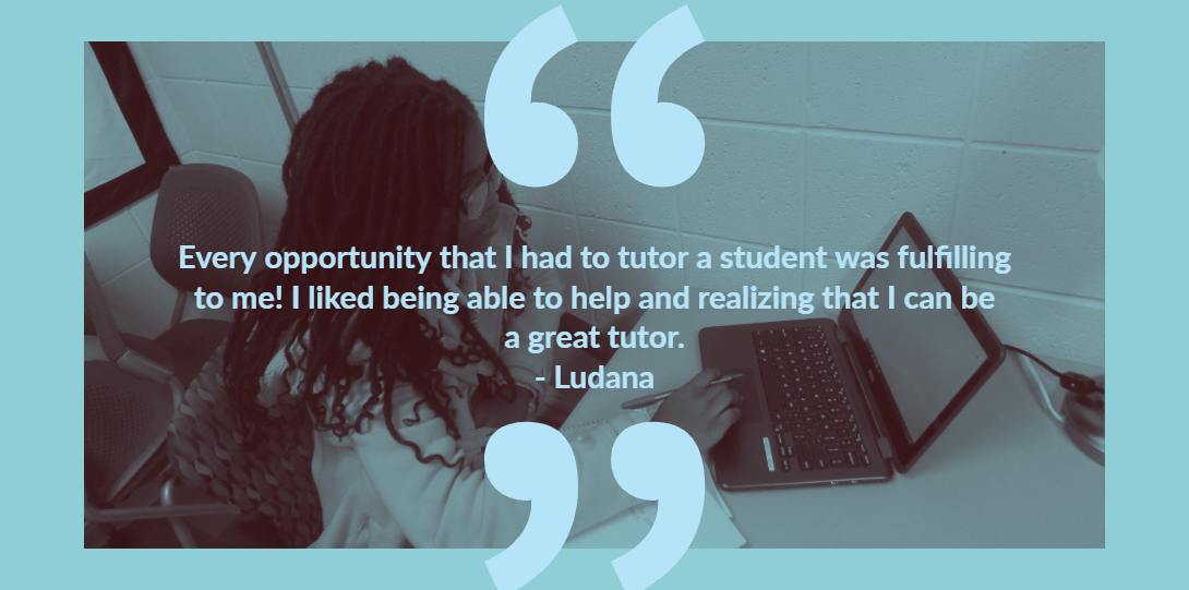 Ludana sitting at a table working on a laptop; her testimony is: Every opportunity that I had to tutor a student was fulfilling to me!