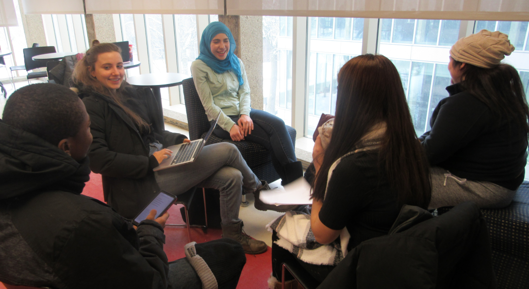 Language students sitting around a table playing a flag card game