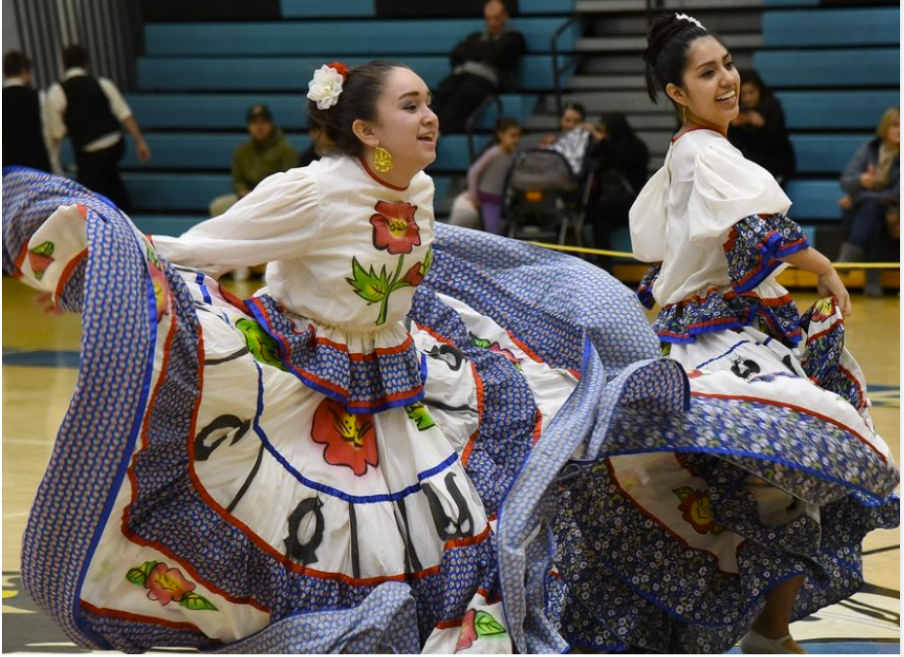 Two Mexican folkloric dancers perform during an International Celebration