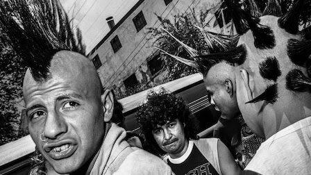 Latino punk rockers sporting mohawk hairstyles